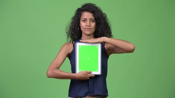Thumbnail for Young Beautiful Hispanic Businesswoman Showing Digital Tablet