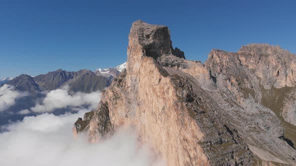 Thumbnail for Aerial Shot of Flying Over the Mountain Peaks Among the Clouds