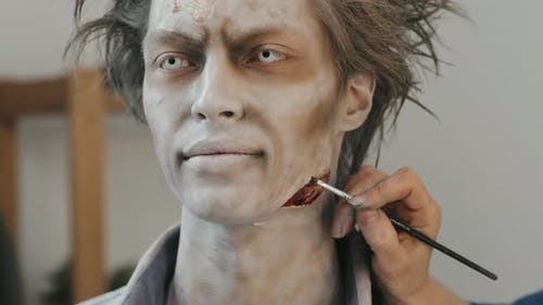 SFX Makeup Artist Making Fake Wound on Man