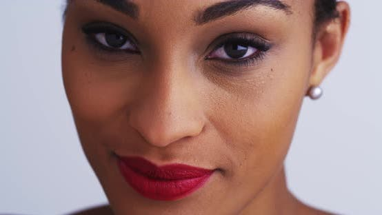 Thumbnail for Attractive african woman looking at camera