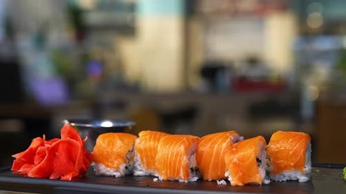Salmon roll sushi with cheese. Tasty sushi with salmon on top.