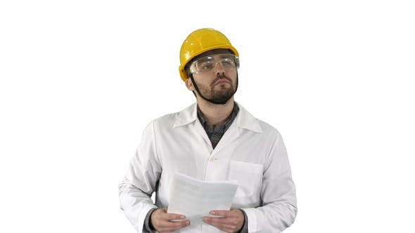 Cover Image for Site engineer cheching papers and something around him