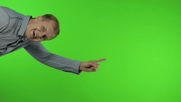Thumbnail for Man Showing Advertising Area. Looking Shocked, Pointing with Hands for Your Promotional Text, Logo