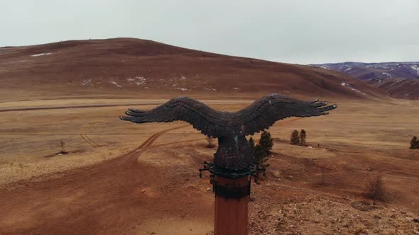 Cover Image for Aerial Shot of a Bronze Monument Eagle