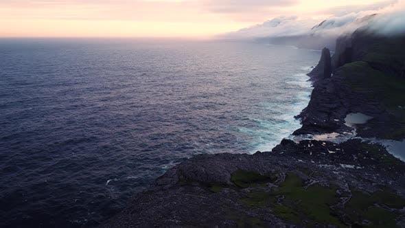 Scenic aerial view of a cliff on North Atlantic sea, Faroe island.