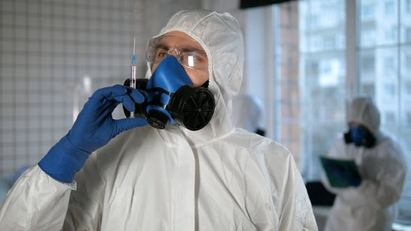 Thumbnail for Covid-19 vaccine. Medical doctor in protective gear preparing