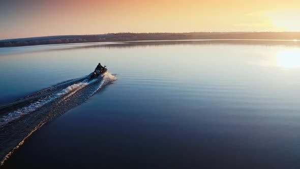 Thumbnail for Boat on Water Surface at Sunset