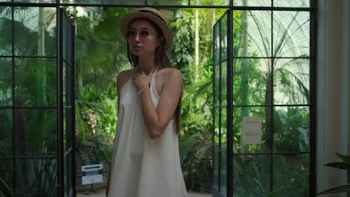 Young Brunette in the Greenhouse