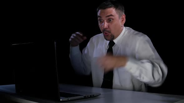 Thumbnail for Businessman in Awe of What He Saw in the Laptop