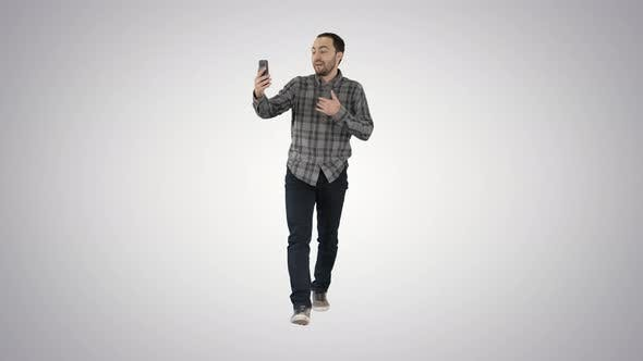 Thumbnail for Man Talking to a Smartphone