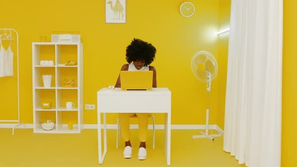 Black Woman In Yellow Room