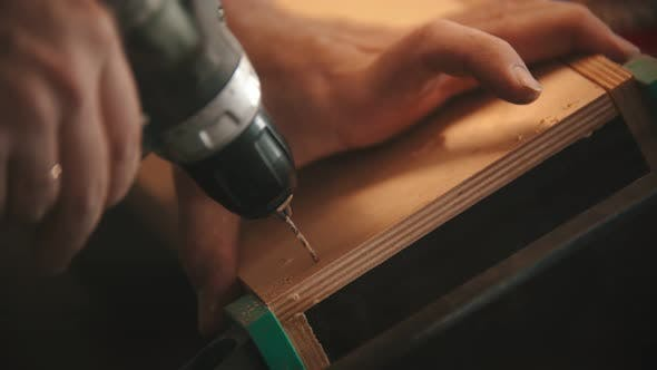 Thumbnail for Carpentry Industry- Man Worker Drilling the Holes in Plywood