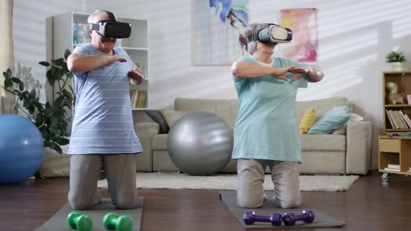 Thumbnail for Senior Couple in VR Headsets Exercising at Home