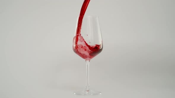 Pouring Red Wine in Glass at 1000 Fps Slow Motion Shot with White Background