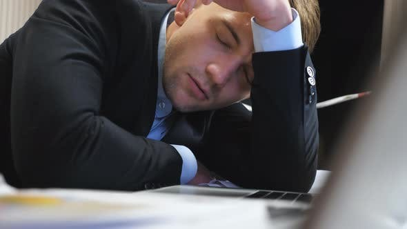 Dolly Shot to Tired Boss in Formal Suit Falling Asleep on Table at Boardroom