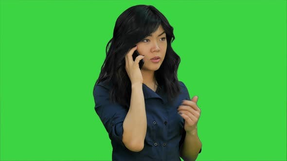 Thumbnail for Businesswoman in Blue Suit Talking on the Cell Phone on a Green Screen, Chroma Key