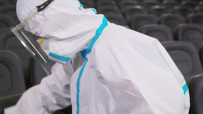 Worker Cleaning with Disinfectants for Chairs