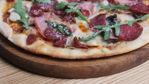 Appetizing Pizza on a Wooden Board in a Restaurant