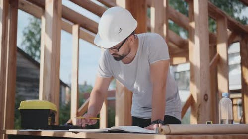 Engineer or Foreman at a Construction Site, Working with Drawings