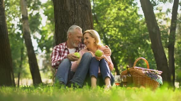 Family Weekend, Retired Couple Sitting in Park and Eating Green Apples, Picnic