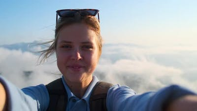 Excited Girl Backpacker in the Mountains Selfie Video