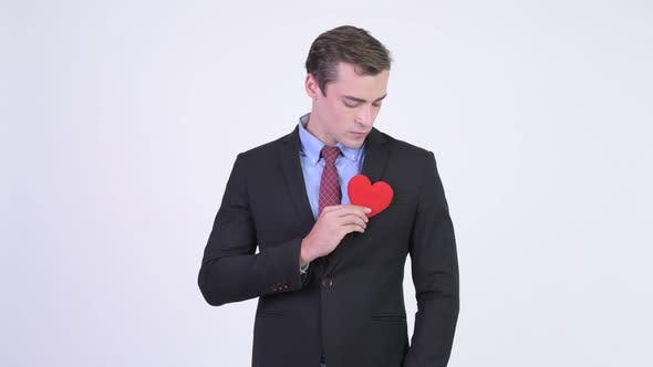 Thumbnail for Young Happy Handsome Businessman Giving Red Heart
