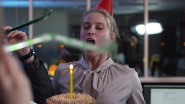 Thumbnail for Businesswoman Blowing Birthday Candle at Office Party