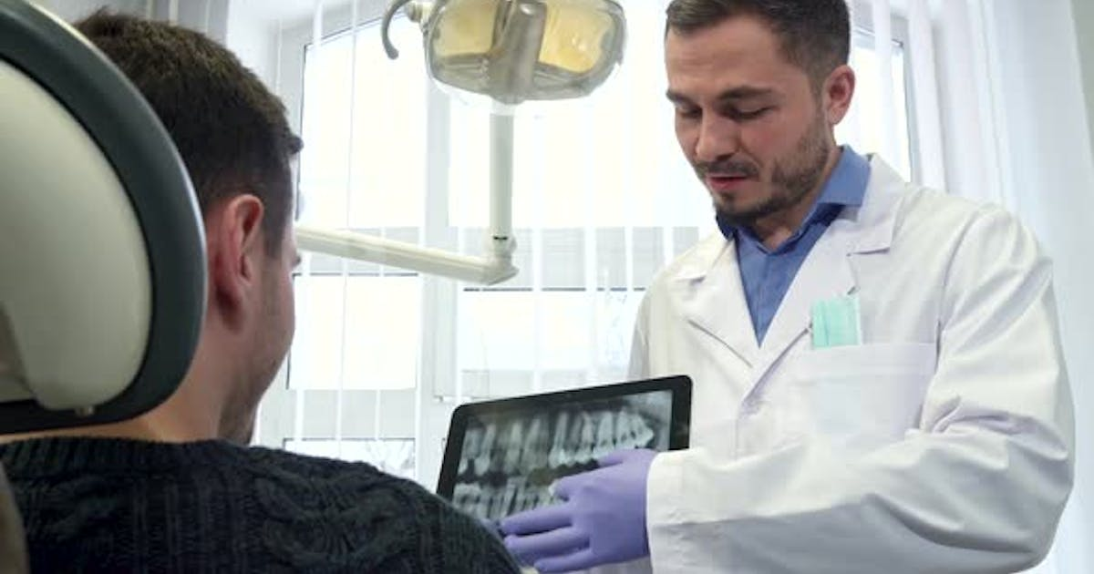 Dental Specialist Moves the Image on the Touchscreen