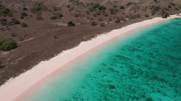 Thumbnail for Drone Over Sandy Coastline With Turquoise Sea