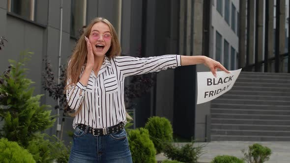 Thumbnail for Excited Teen Girl Showing Black Friday Inscription, Advertising Discounts, Showing Thumbs Up