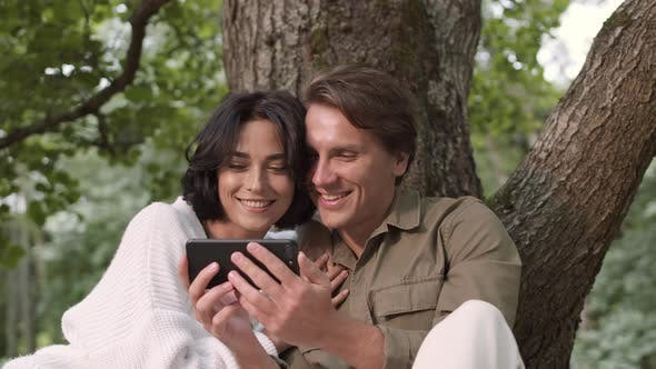 Thumbnail for Couple Using Smartphone during Picnic