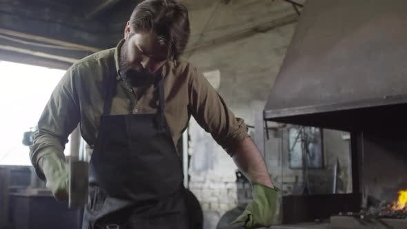 Blacksmith Treating Molting Metal