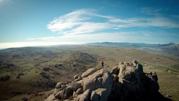Hiker Traveller on Mountain Summit