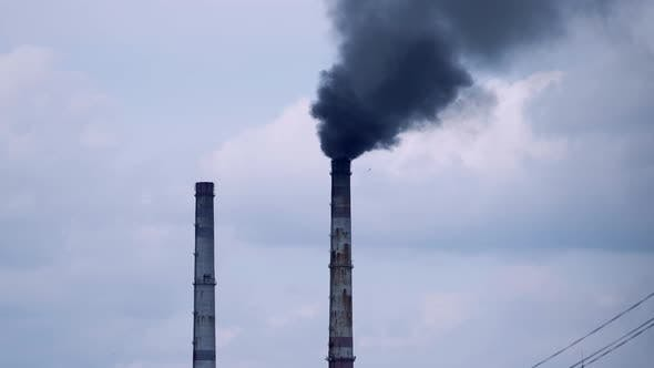 Factory pipes with smoke. Smoke of pipes pollutes atmosphere