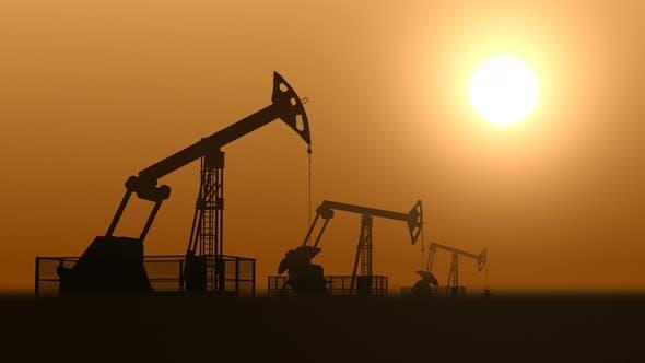 Thumbnail for Oil Pump Jacks in the Desert Extracting Crude Oil against Sunset