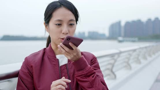 Thumbnail for Woman use of smart phone at outdoor