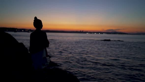 Thumbnail for Dramatic Beach Sunset And Silhouette of Young Woman