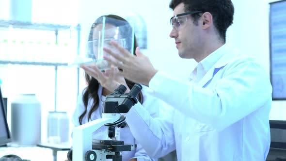 Scientist observing behavior experiment animals
