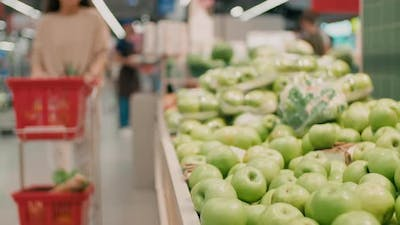 Buying Fresh Apples In Grocery Store