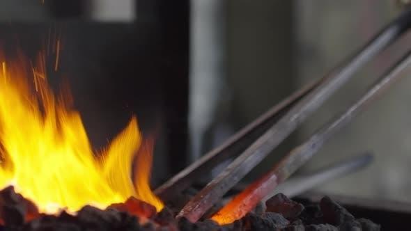 Thumbnail for Craftsman Melting Metal in Coals