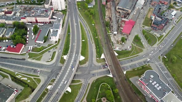 Thumbnail for Aerial Highway Crossroad Top View Moving Cars and Trains on Railway Drone Lapse City Street Traffic