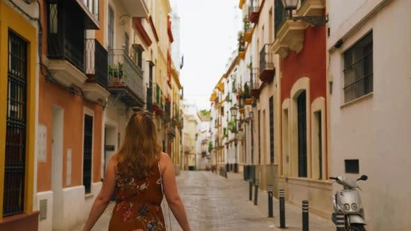Thumbnail for Following Behind Walking Female Traveling European Streets in Spain
