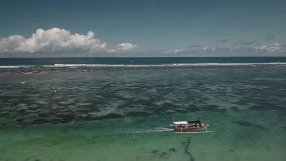 Thumbnail for Aerial View of Traditional Indonesian Boat in Turquoise Crystal Clear Water