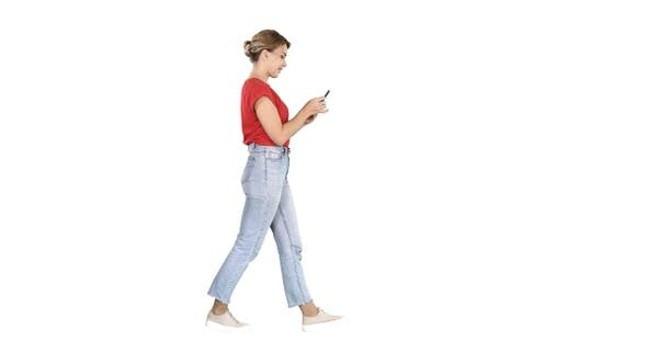 Thumbnail for Beautiful young woman walking and reading text message