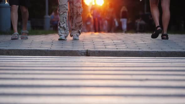 Thumbnail for People Walk in the Evening City at Sunset, in the Frame You Can See the Man's Togas in Camouflage