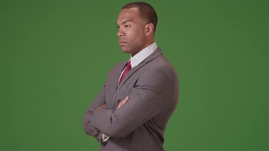Thumbnail for A black businessman looks out confidently on green screen