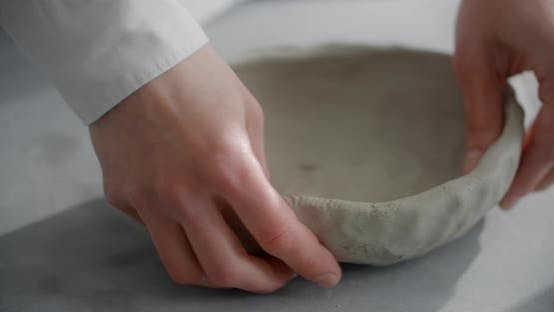 Ceramist Sculpts the Bowl From Piece of a Clay at the Workshop Potter at Work Craftsmanship of