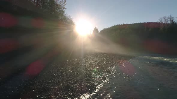 Thumbnail for Dolly Across Forest River Sunrise In Early Morning Lowland Fog Haze