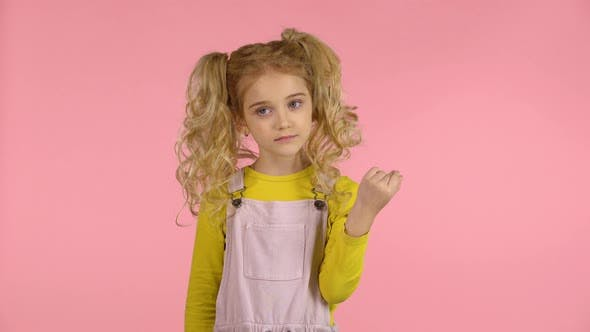 Thumbnail for Cute Female Child Is Winding Her Hair on the Finger
