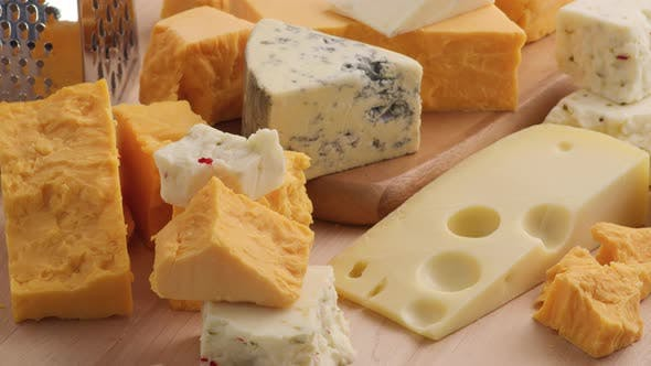 Thumbnail for Variety of Cheeses; Cheddar, Blue Cheese, Swiss, Pepper Jack.